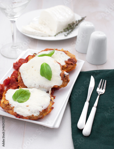 Meat parmigiaana with mozzarella cheese