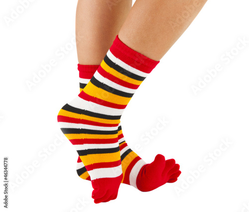 female legs in colorful striped socks