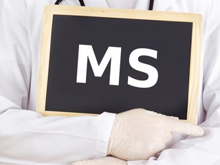 Doctor shows information on blackboard: MS