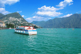 Panorama of lake Lugano with boat, Switzerland, summer
