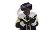 Zwarte Piet is reading in the book of Sinterklaas