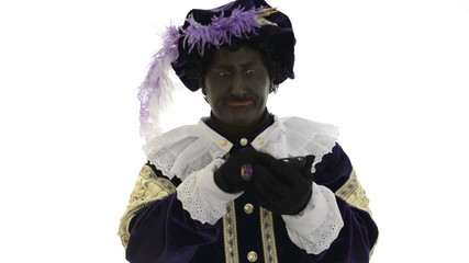 Zwarte Piet is trying to use a mobile phone