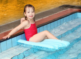 Happy child bathing in a swimming pool.