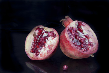 Pomegranates on black background