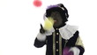 Zwarte Piet is juggling with colored balls