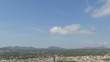 Time lapse view over the city of Arta with clouds passing by