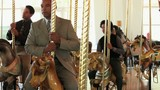Group of serious businessmen in suits riding carousel horses