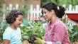 Mother teaching daughter to plant tomatoes in vegetable garden