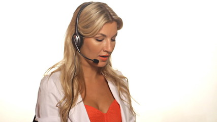 Close up of positive customer service woman talking on headset