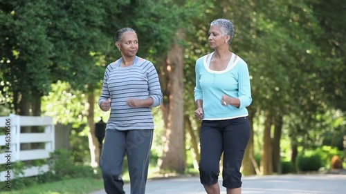 Mature Black women walking briskly in neighborhood