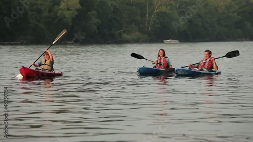 Caucasian family in kayaks on river