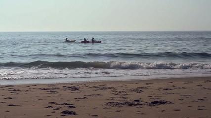 People in kayaks in ocean