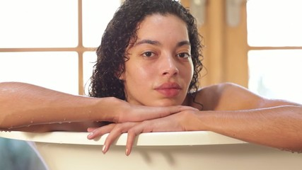 Portrait of mixed woman in bathtub