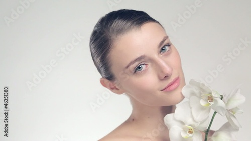 Beautiful model studio holding white flower