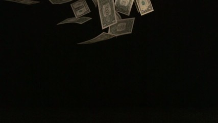 One dollar bills falling through the air (slow motion)