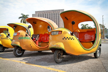 Yellow coco taxi in  Havana