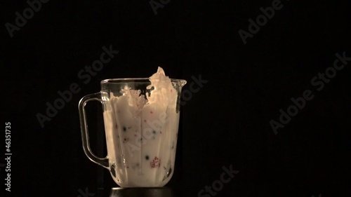 Fruit and milk flying out of blender (slow motion)