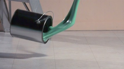 Can of paint falling onto the floor (slow motion)