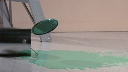 Paint can lid falling into pool of paint (slow motion)