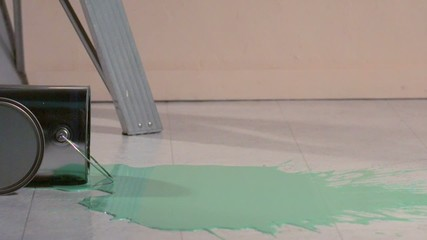 Paint can lid rolling through pool of paint (slow motion)