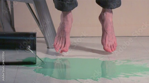 Caucasian woman's bare feet jumping in paint (slow motion)
