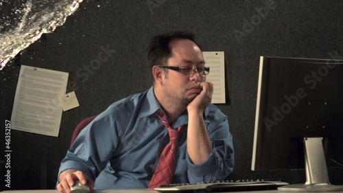 Asian businessman, sleeping at computer, getting splashed with water (slow motion)