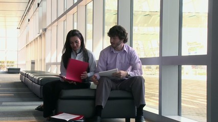 Business people looking at paperwork in conference center
