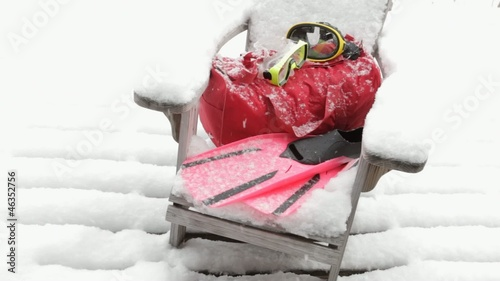 Snorkel gear on snow covered Andirondack chair
