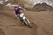Motocross party rides standing cornering the furrow