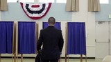 Businessman entering voting booth