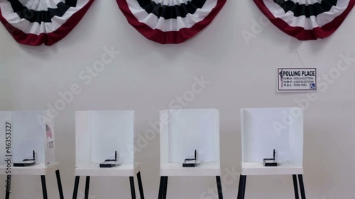 Clip of interior of polling place with row of voting booths