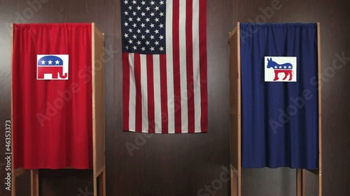 Voting booths with Democrat and Republican logos on curtains, American flag in background