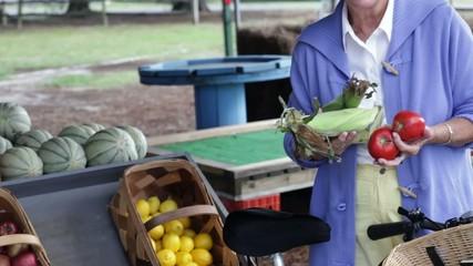 Senior Caucasian woman holding produce at the farmer's market