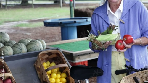 Senior Caucasian woman holding produce at the farmer's market