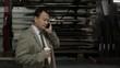 Hispanic factory supervisor talking on cell phone