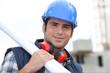 Tradesman carrying blueprints