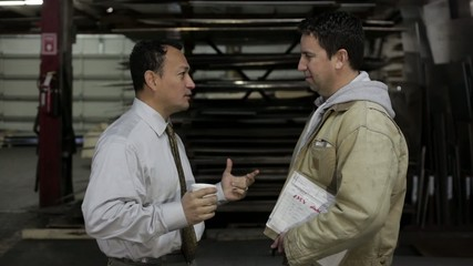 Factory supervisor talking to the foreman