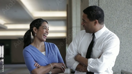 Businesswoman making co-worker laugh