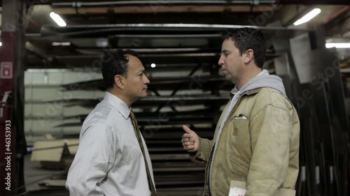 Factory foreman in an angry exchange with supervisor