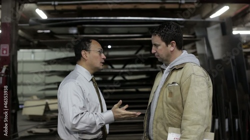 Factory supervisor and foreman having a heated discussion