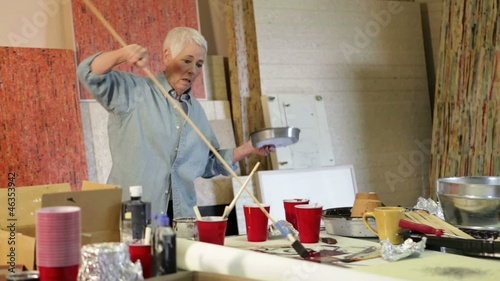 Senior Caucasian woman painting in studio