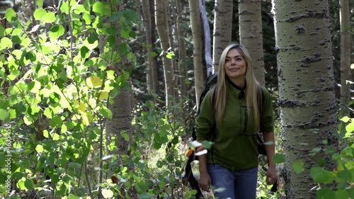 Hispanic woman hiking in woods