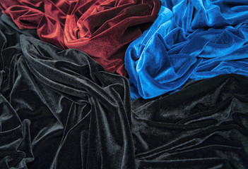 blue red and black glossy velvet with folds