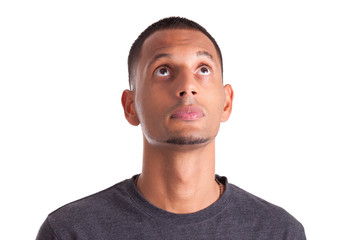 Close up portrait of a young african american man looking up