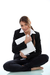 A cute businesswoman hugging a file.