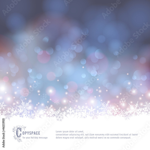 winter background with snow and defocused lights