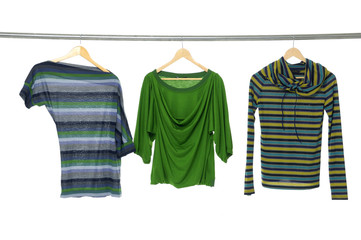 Fashion striped Shirts clothing hanging on hangers