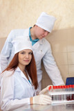 nurse and male doctor with test tubes