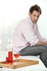 depressed man looking a wine bottle