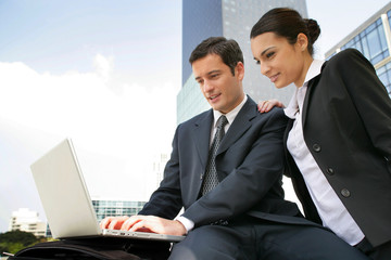 businessman and businesswoman working outdoors